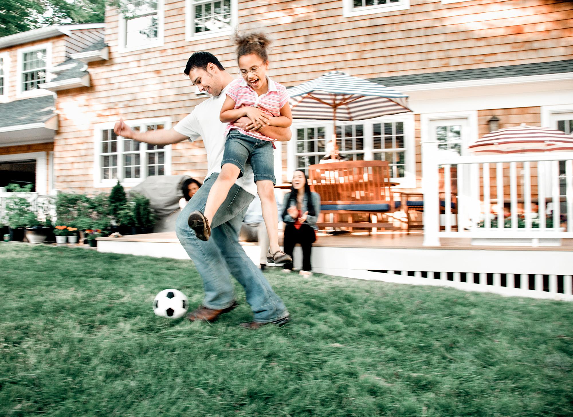 Family in Big Backyard | THA Mortgage